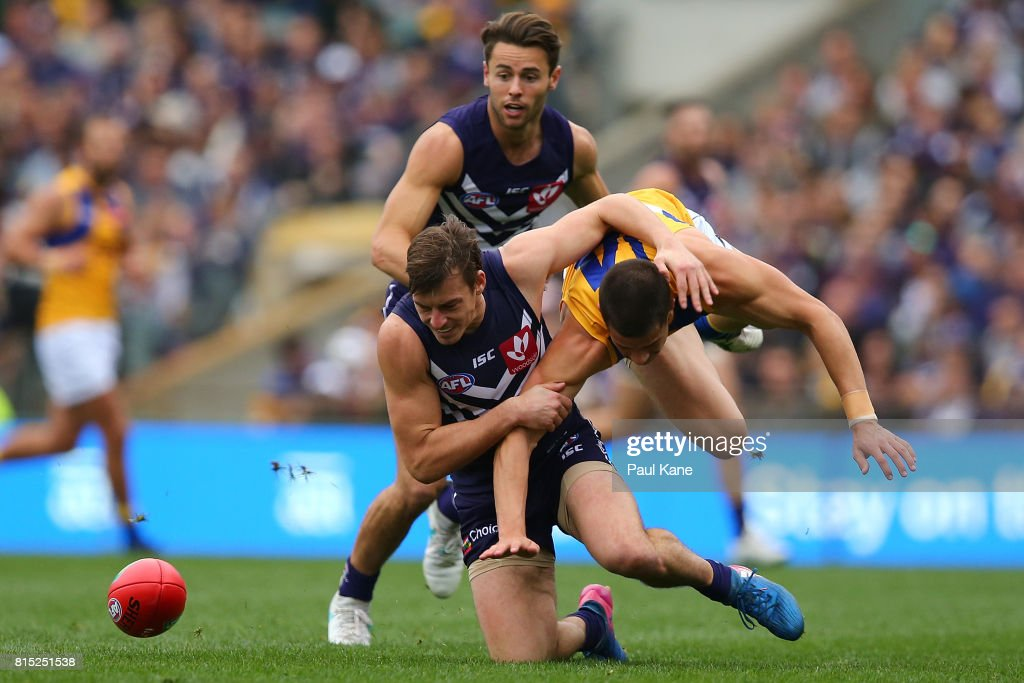 Nick Suban of the Dockers and Liam Duggan of the Eagles contest for the ball during the round 17 AFL match between the Fremantle Dockers and the West Coast Eagles at Domain Stadium on July 16, 2017 in Perth, Australia.