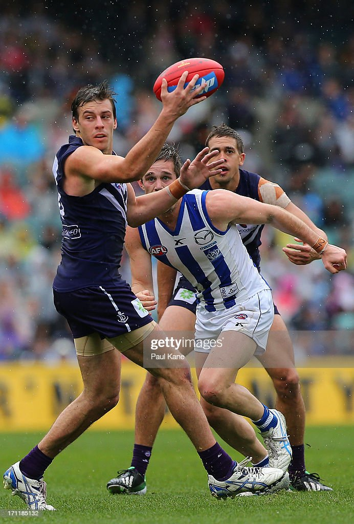 Nick Suban of the Dockers gathers the ball during the round 13 AFL match between the Fremantle Dockers and the North Melbourne Kangaroos at Patersons Stadium on June 23, 2013 in Perth, Australia.