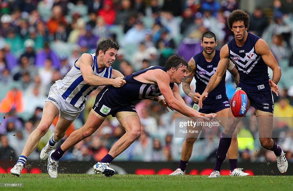 Nick Suban of the Dockers handballs during the round 13 AFL match between the Fremantle Dockers and the North Melbourne Kangaroos at Patersons Stadium on June 23, 2013 in Perth, Australia.