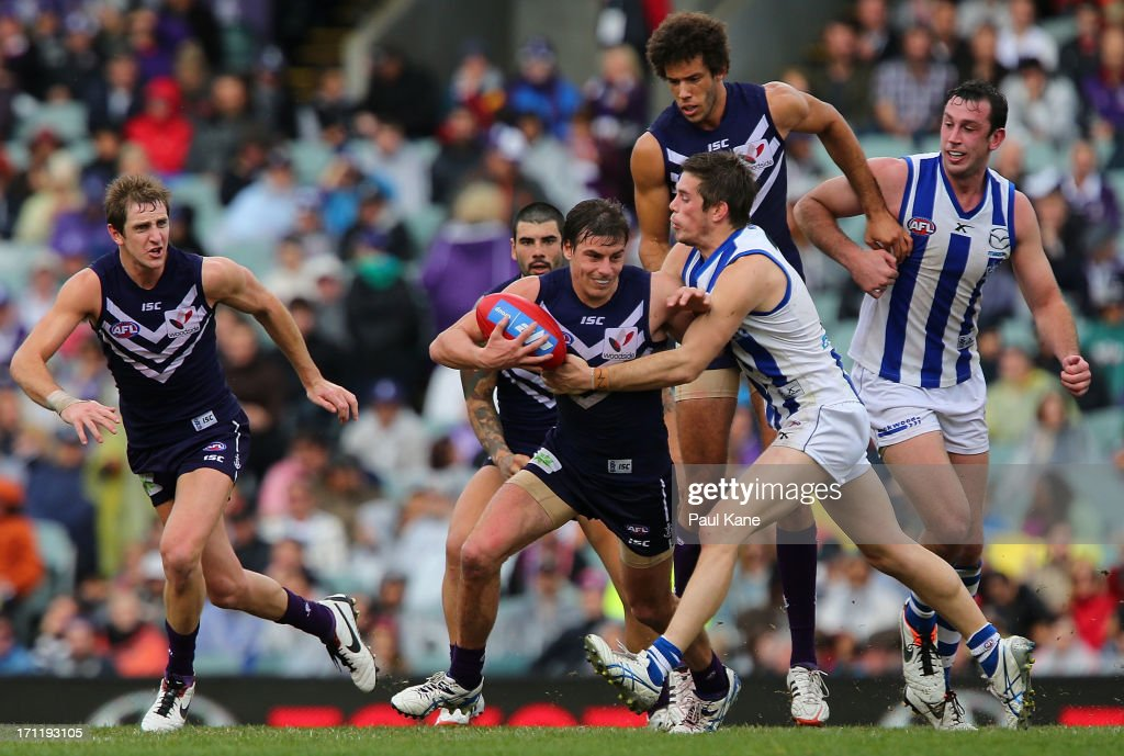 Nick Suban of the Dockers looks to break from a tackle during the round 13 AFL match between the Fremantle Dockers and the North Melbourne Kangaroos at Patersons Stadium on June 23, 2013 in Perth, Australia.