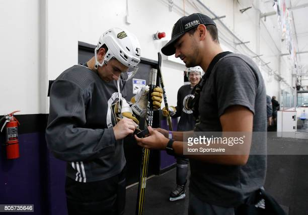 Nick Suzuki autographs a puck at the conclusion of the Vegas Golden Knights Development Camp at the Las Vegas Ice Center on July 01 2017 in Las Vegas...