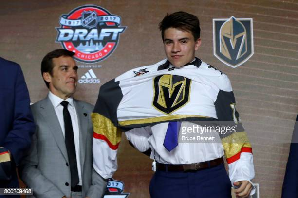 Nick Suzuki puts on the Vegas Golden Knights jersey after being selected 13th overall during the 2017 NHL Draft at the United Center on June 23 2017...