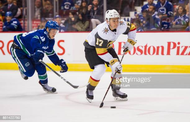 Nick Suzukiof the Las Vegas Golden Knights skates with the puck while pursued by Olli Juolevi of the Vancouver Canucks in NHL preseason action on...