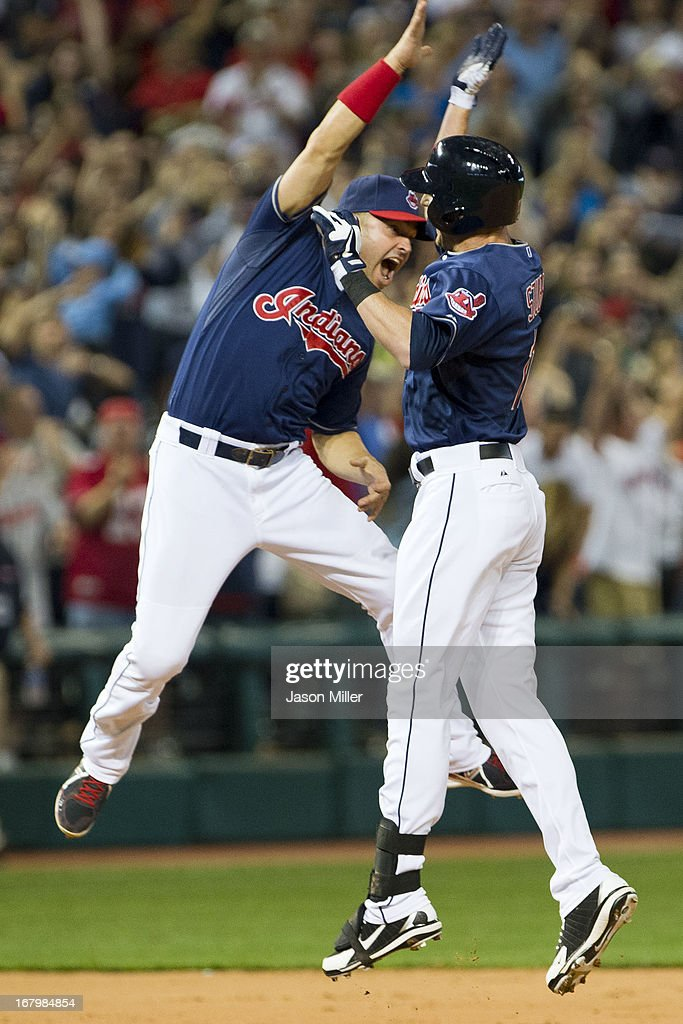 <a gi-track='captionPersonalityLinkClicked' href=/galleries/search?phrase=Nick+Swisher&family=editorial&specificpeople=206417 ng-click='$event.stopPropagation()'>Nick Swisher</a> #33 celebrates with <a gi-track='captionPersonalityLinkClicked' href=/galleries/search?phrase=Drew+Stubbs+-+Baseball+Player&family=editorial&specificpeople=4498334 ng-click='$event.stopPropagation()'>Drew Stubbs</a> #11 of the Cleveland Indians after Stubs hit a walk-off double to center during the tenth inning against the Minnesota Twins at Progressive Field on May 3, 2013 in Cleveland, Ohio. The Indians defeated the Twins 7-6.