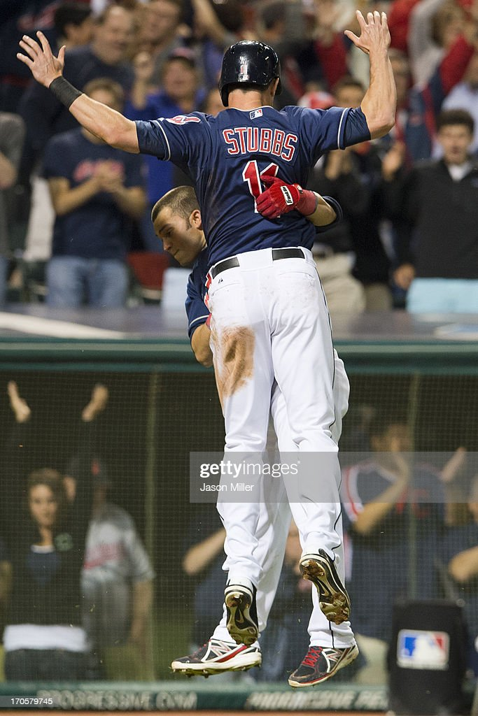 <a gi-track='captionPersonalityLinkClicked' href=/galleries/search?phrase=Nick+Swisher&family=editorial&specificpeople=206417 ng-click='$event.stopPropagation()'>Nick Swisher</a> #33 celebrates with <a gi-track='captionPersonalityLinkClicked' href=/galleries/search?phrase=Drew+Stubbs+-+Baseball+Player&family=editorial&specificpeople=4498334 ng-click='$event.stopPropagation()'>Drew Stubbs</a> #11 of the Cleveland Indians after Stubbs scored the game-winning run on a fielder's choice by Jason Kipnis (not pictured) during the ninth inning against the Washington Nationals at Progressive Field on June 14, 2013 in Cleveland, Ohio. The Indians defeated the Nationals 2-1.