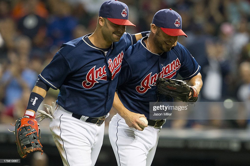 <a gi-track='captionPersonalityLinkClicked' href=/galleries/search?phrase=Nick+Swisher&family=editorial&specificpeople=206417 ng-click='$event.stopPropagation()'>Nick Swisher</a> #33 celebrates with <a gi-track='captionPersonalityLinkClicked' href=/galleries/search?phrase=Ryan+Raburn&family=editorial&specificpeople=2541483 ng-click='$event.stopPropagation()'>Ryan Raburn</a> #9 of the Cleveland Indians after Raburn, who normally plays outfield, pitched during the ninth inning against the Detroit Tigers Progressive Field on August 8, 2013 in Cleveland, Ohio.