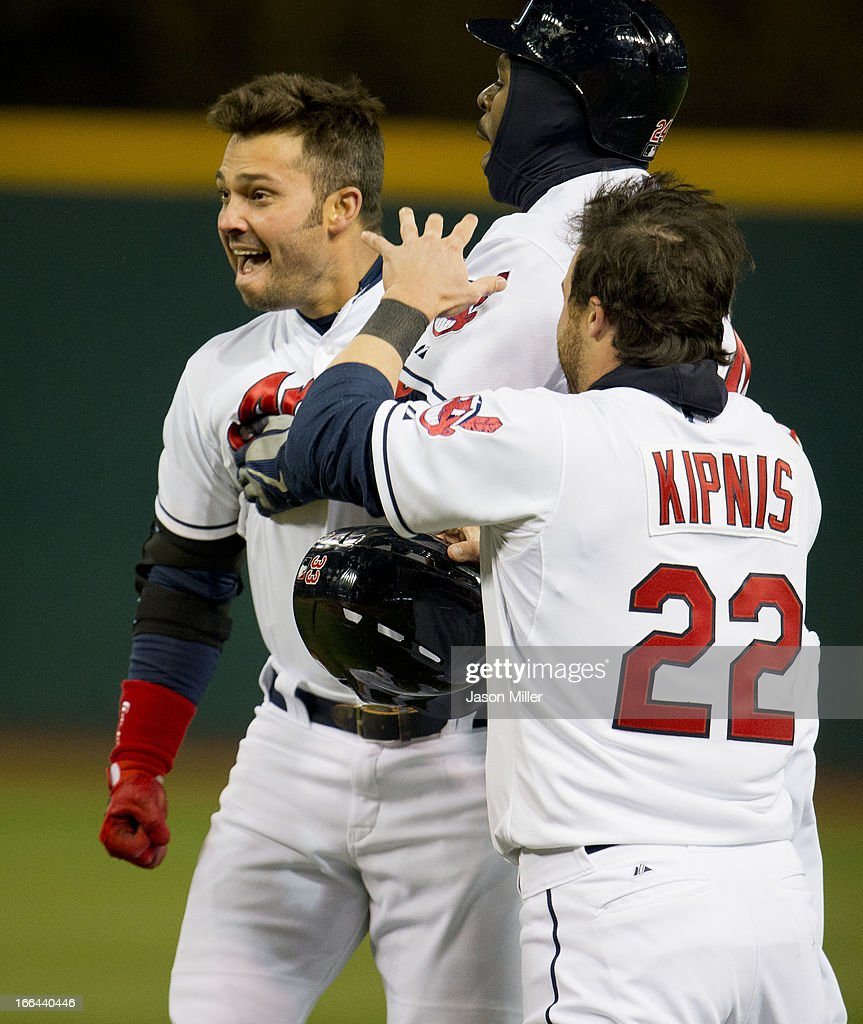 <a gi-track='captionPersonalityLinkClicked' href=/galleries/search?phrase=Nick+Swisher&family=editorial&specificpeople=206417 ng-click='$event.stopPropagation()'>Nick Swisher</a> #33, <a gi-track='captionPersonalityLinkClicked' href=/galleries/search?phrase=Michael+Bourn&family=editorial&specificpeople=835742 ng-click='$event.stopPropagation()'>Michael Bourn</a> #24 and <a gi-track='captionPersonalityLinkClicked' href=/galleries/search?phrase=Jason+Kipnis&family=editorial&specificpeople=5330784 ng-click='$event.stopPropagation()'>Jason Kipnis</a> #22 of the Cleveland Indians celebrate after Swisher hit a game-winning single in the ninth inning against the Chicago White Sox at Progressive Field on April 12, 2013 in Cleveland, Ohio.