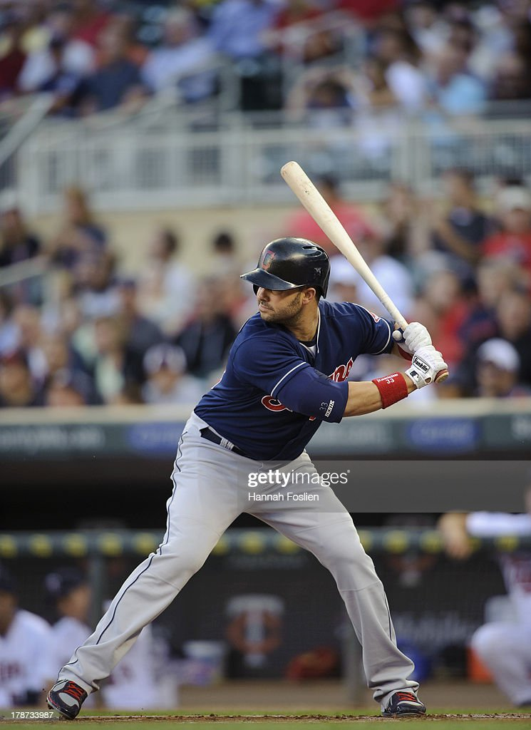 <a gi-track='captionPersonalityLinkClicked' href=/galleries/search?phrase=Nick+Swisher&family=editorial&specificpeople=206417 ng-click='$event.stopPropagation()'>Nick Swisher</a> #33 of the Cleveland Indians bats against the Minnesota Twins on August 13, 2013 at Target Field in Minneapolis, Minnesota.