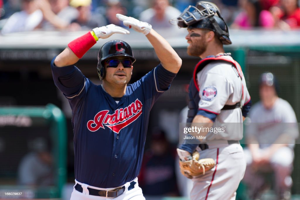 <a gi-track='captionPersonalityLinkClicked' href=/galleries/search?phrase=Nick+Swisher&family=editorial&specificpeople=206417 ng-click='$event.stopPropagation()'>Nick Swisher</a> #33 of the Cleveland Indians celebrates after hitting a solo home run during the first inning against the Minnesota Twins at Progressive Field on May 4, 2013 in Cleveland, Ohio.