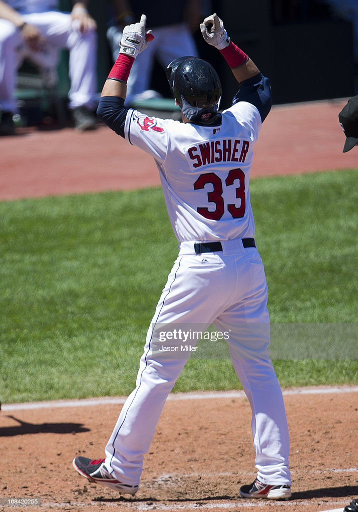<a gi-track='captionPersonalityLinkClicked' href=/galleries/search?phrase=Nick+Swisher&family=editorial&specificpeople=206417 ng-click='$event.stopPropagation()'>Nick Swisher</a> #33 of the Cleveland Indians celebrates after hitting a solo home run during the third inning against the Oakland Athletics at Progressive Field on May 9, 2013 in Cleveland, Ohio.