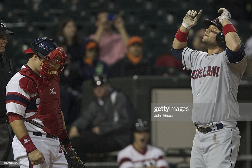 <a gi-track='captionPersonalityLinkClicked' href=/galleries/search?phrase=Nick+Swisher&family=editorial&specificpeople=206417 ng-click='$event.stopPropagation()'>Nick Swisher</a> #33 of the Cleveland Indians celebrates hitting a solo home run as Josh Phegley #36 of the Chicago White Sox looks away during the sixth inning of their MLB game at U.S. Cellular Field on September 15, 2013 in Chicago, Illinois.