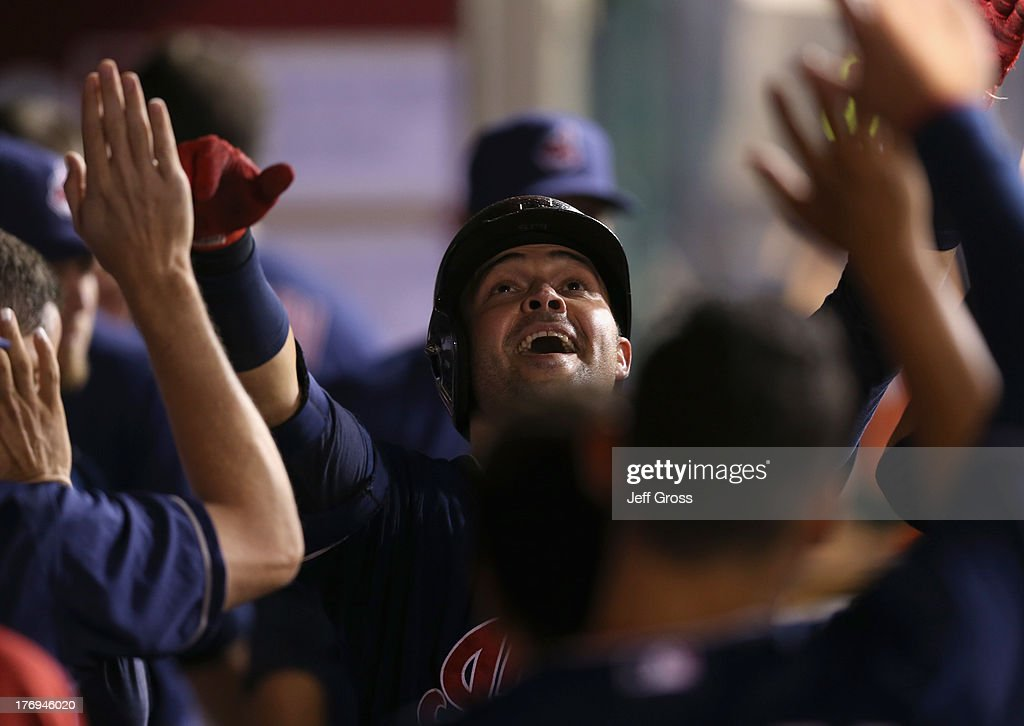 <a gi-track='captionPersonalityLinkClicked' href=/galleries/search?phrase=Nick+Swisher&family=editorial&specificpeople=206417 ng-click='$event.stopPropagation()'>Nick Swisher</a> #33 of the Cleveland Indians celebrates in the dugout after hitting a solo home run in the ninth inning against the Los Angeles Angels of Anaheim at Angel Stadium of Anaheim on August 19, 2013 in Anaheim, California. The Indians defeated the Angels 5-2.
