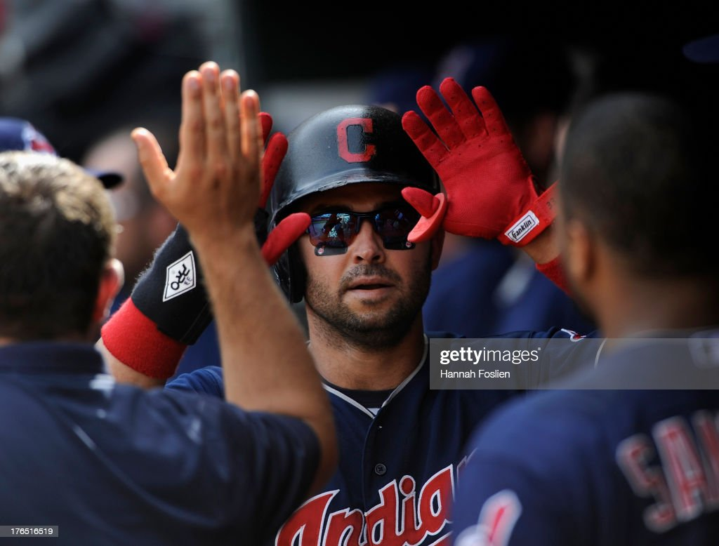 <a gi-track='captionPersonalityLinkClicked' href=/galleries/search?phrase=Nick+Swisher&family=editorial&specificpeople=206417 ng-click='$event.stopPropagation()'>Nick Swisher</a> #33 of the Cleveland Indians celebrates scoring a run against the Minnesota Twins during the twelfth inning of the game on August 14, 2013 at Target Field in Minneapolis, Minnesota. The Indians defeated the Twins 9-8 in twelve innings.
