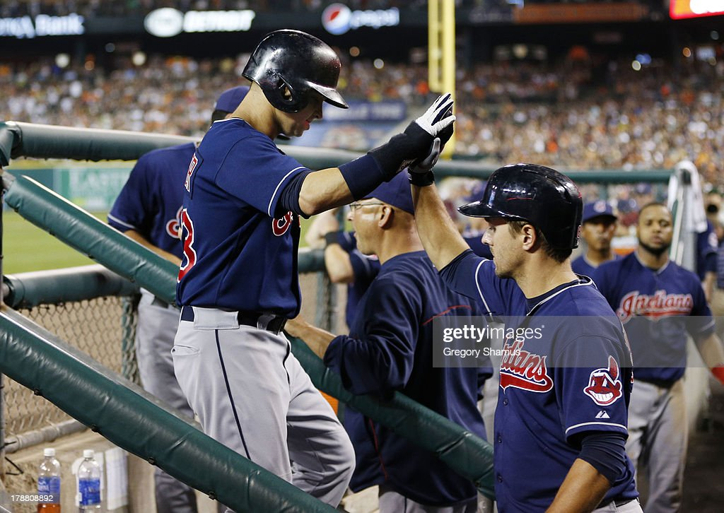 <a gi-track='captionPersonalityLinkClicked' href=/galleries/search?phrase=Nick+Swisher&family=editorial&specificpeople=206417 ng-click='$event.stopPropagation()'>Nick Swisher</a> #33 of the Cleveland Indians celebrates scoring a seventh inning run as he returns to the dugout while playing the Detroit Tigers at Comerica Park on August 30, 2013 in Detroit, Michigan.