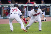 Nick Swisher of the Cleveland Indians celebrates with Jason Kipnis after Swisher hit a solo home run during the first inning against the Texas...