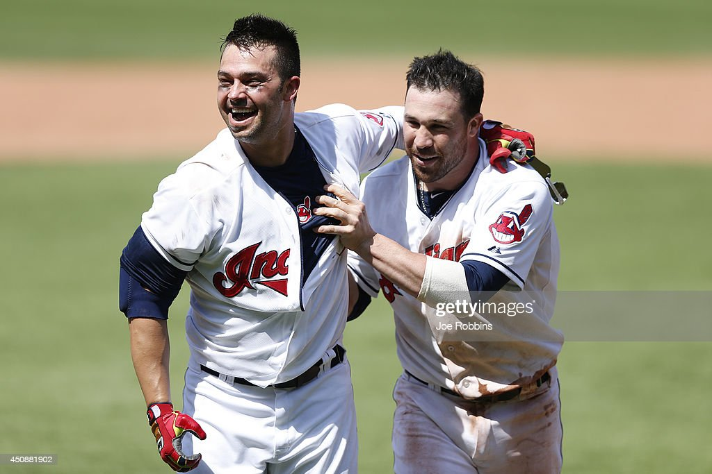 <a gi-track='captionPersonalityLinkClicked' href=/galleries/search?phrase=Nick+Swisher&family=editorial&specificpeople=206417 ng-click='$event.stopPropagation()'>Nick Swisher</a> #33 of the Cleveland Indians celebrates with <a gi-track='captionPersonalityLinkClicked' href=/galleries/search?phrase=Jason+Kipnis&family=editorial&specificpeople=5330784 ng-click='$event.stopPropagation()'>Jason Kipnis</a> #22 after his walk off grand slam in the tenth inning of the game against the Los Angeles Angels of Anaheim at Progressive Field on June 19, 2014 in Cleveland, Ohio. The Indians won 5-3.