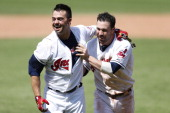 Nick Swisher of the Cleveland Indians celebrates with Jason Kipnis after his walk off grand slam in the tenth inning of the game against the Los...