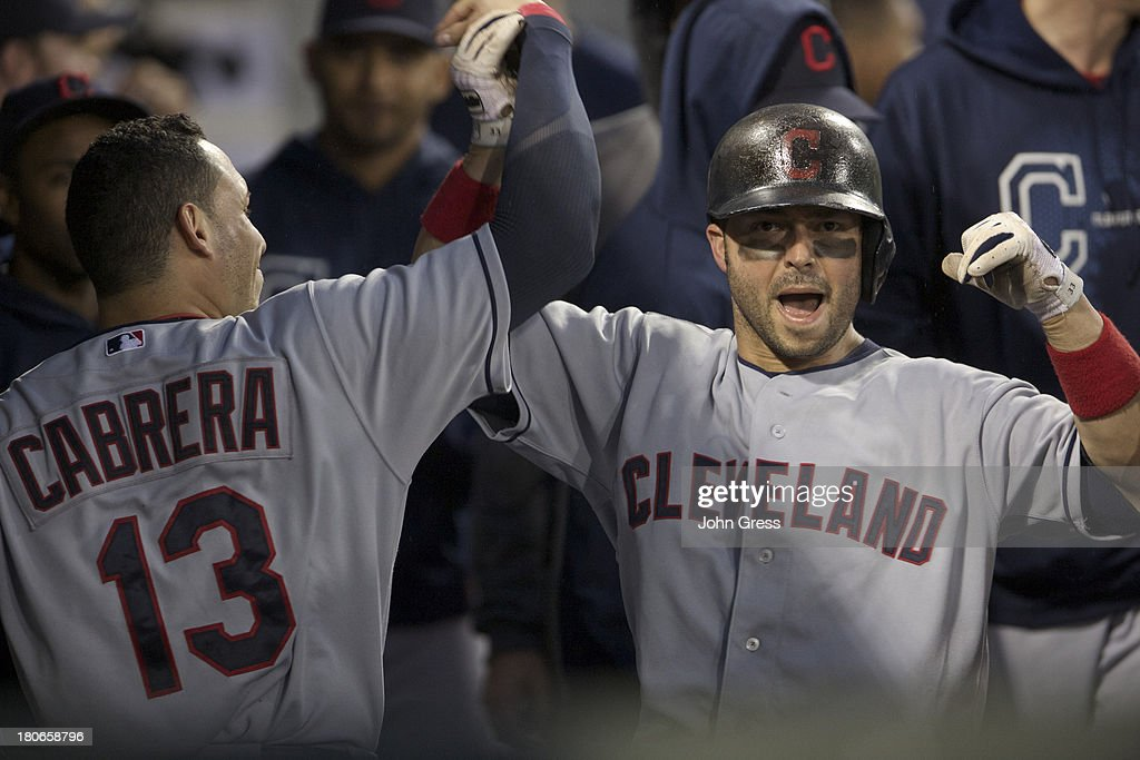 <a gi-track='captionPersonalityLinkClicked' href=/galleries/search?phrase=Nick+Swisher&family=editorial&specificpeople=206417 ng-click='$event.stopPropagation()'>Nick Swisher</a> #33 of the Cleveland Indians celebrates with teammate <a gi-track='captionPersonalityLinkClicked' href=/galleries/search?phrase=Asdrubal+Cabrera&family=editorial&specificpeople=834042 ng-click='$event.stopPropagation()'>Asdrubal Cabrera</a> #13 after hitting a solo home run during the sixth inning of their MLB game at U.S. Cellular Field on September 15, 2013 in Chicago, Illinois.