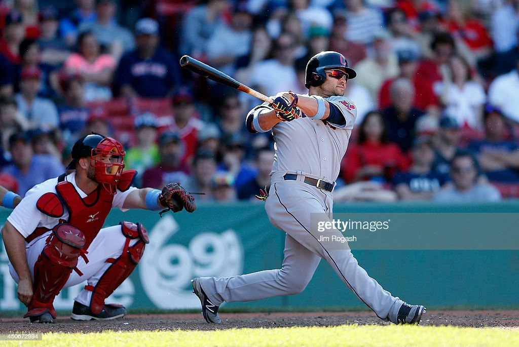 Nick Swisher of the Cleveland Indians connects for a goahead home run in the 11th inning against the Boston Red Sox at Fenway Park on June 15 2014 in...