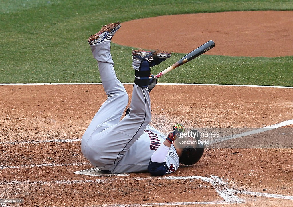 Nick Swisher of the Cleveland Indians falls over after fouling a ball off of his foot against the Chicago White Sox at US Cellular Field on April 13...