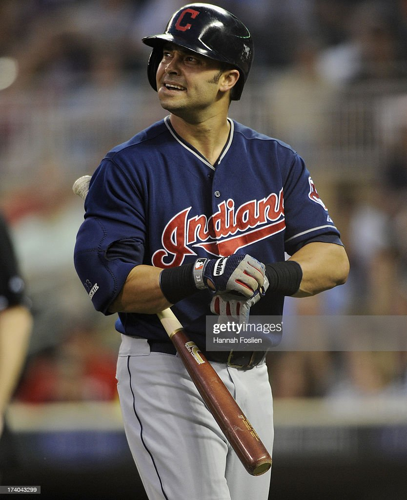 <a gi-track='captionPersonalityLinkClicked' href=/galleries/search?phrase=Nick+Swisher&family=editorial&specificpeople=206417 ng-click='$event.stopPropagation()'>Nick Swisher</a> #33 of the Cleveland Indians heads to the dugout after striking out against the Minnesota Twins during the sixth inning of the game on July 19, 2013 at Target Field in Minneapolis, Minnesota. The Twins defeated the Indians 3-2.