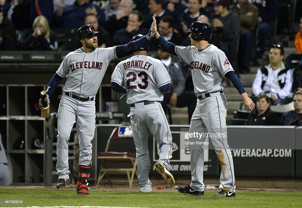 <a gi-track='captionPersonalityLinkClicked' href=/galleries/search?phrase=Nick+Swisher&family=editorial&specificpeople=206417 ng-click='$event.stopPropagation()'>Nick Swisher</a> #33 of the Cleveland Indians (L) high-fives teammate <a gi-track='captionPersonalityLinkClicked' href=/galleries/search?phrase=Drew+Stubbs+-+Baseball+Player&family=editorial&specificpeople=4498334 ng-click='$event.stopPropagation()'>Drew Stubbs</a> #11 (R) after Stubbs and Michael Brantley #23 scored on an RBI single hit by Asdrubal Cabrera #13 during the eighth inning against the Chicago White Sox on April 22, 2012 at U.S. Cellular Field in Chicago, Illinois.