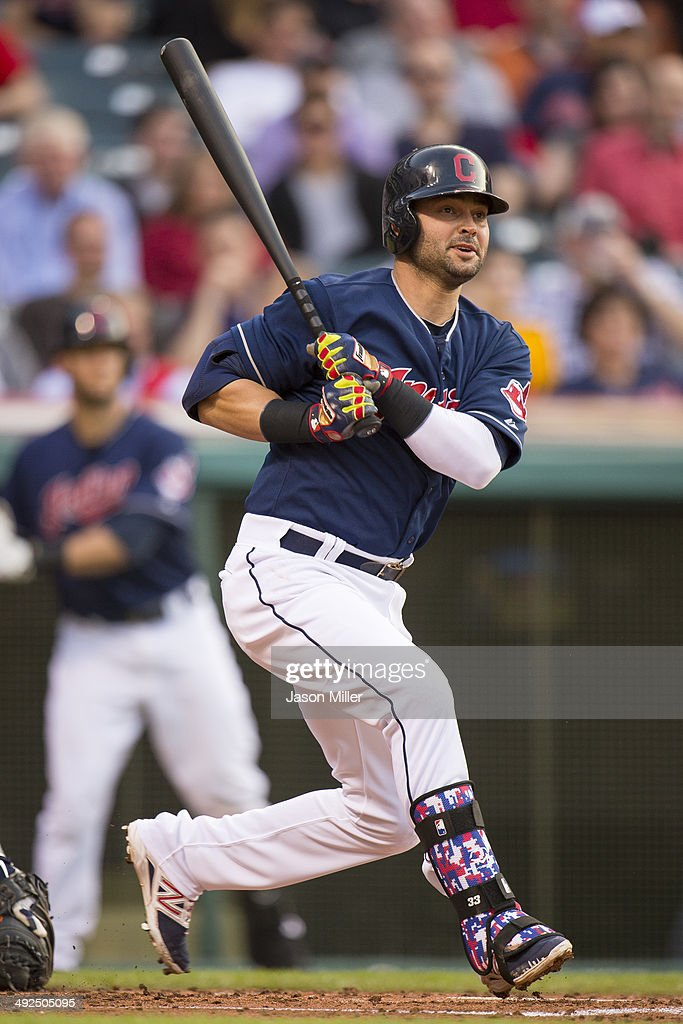 <a gi-track='captionPersonalityLinkClicked' href=/galleries/search?phrase=Nick+Swisher&family=editorial&specificpeople=206417 ng-click='$event.stopPropagation()'>Nick Swisher</a> #33 of the Cleveland Indians hits a double to right field during the second inning against the Detroit Tigers at Progressive Field on May 20, 2014 in Cleveland, Ohio.