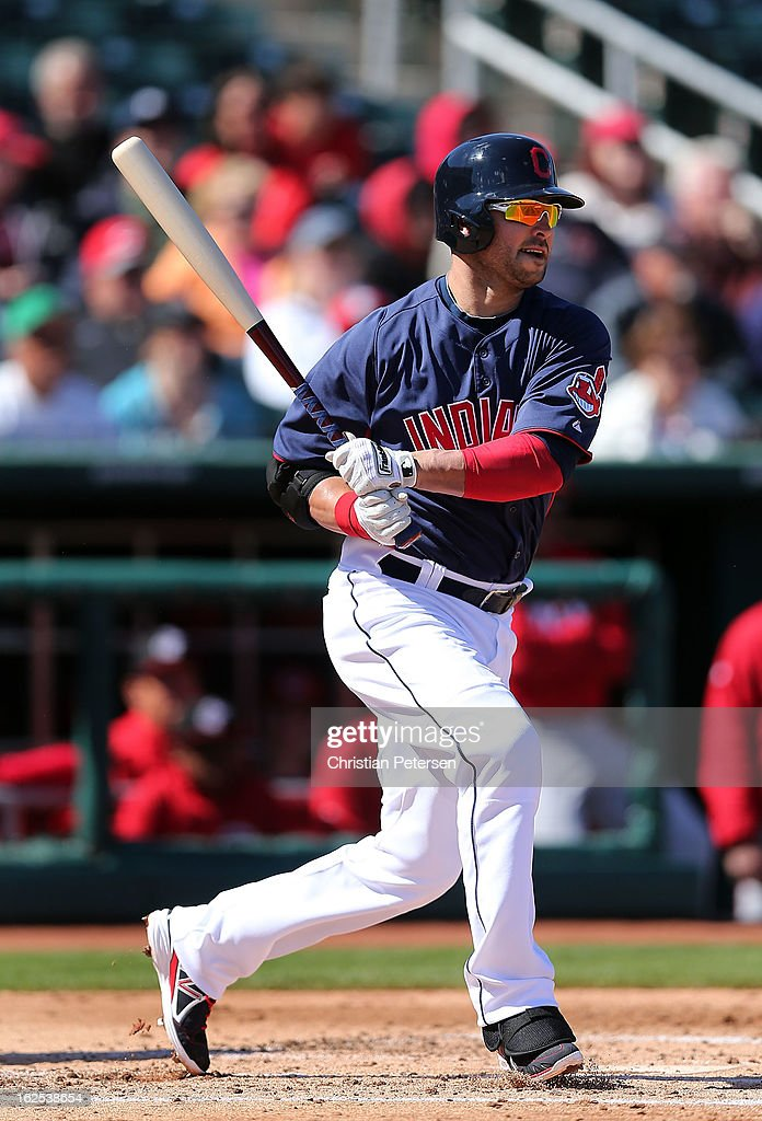 <a gi-track='captionPersonalityLinkClicked' href=/galleries/search?phrase=Nick+Swisher&family=editorial&specificpeople=206417 ng-click='$event.stopPropagation()'>Nick Swisher</a> #33 of the Cleveland Indians hits a single against the Cincinnati Reds during the second inning of the spring training game at Goodyear Ballpark on February 24, 2013 in Goodyear, Arizona