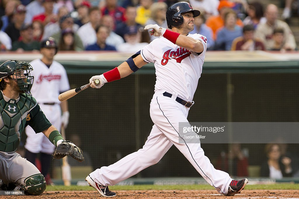 <a gi-track='captionPersonalityLinkClicked' href=/galleries/search?phrase=Nick+Swisher&family=editorial&specificpeople=206417 ng-click='$event.stopPropagation()'>Nick Swisher</a> #33 of the Cleveland Indians hits a single during the third inning against the Oakland Athletics at Progressive Field on May 6, 2013 in Cleveland, Ohio.