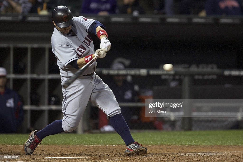 <a gi-track='captionPersonalityLinkClicked' href=/galleries/search?phrase=Nick+Swisher&family=editorial&specificpeople=206417 ng-click='$event.stopPropagation()'>Nick Swisher</a> #33 of the Cleveland Indians hits a solo home run of of the Chicago White Sox during the sixth inning of their MLB game at U.S. Cellular Field on September 15, 2013 in Chicago, Illinois.