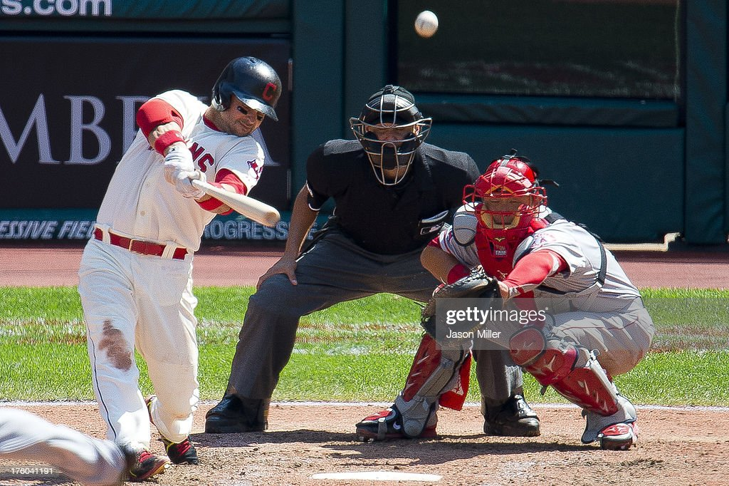 <a gi-track='captionPersonalityLinkClicked' href=/galleries/search?phrase=Nick+Swisher&family=editorial&specificpeople=206417 ng-click='$event.stopPropagation()'>Nick Swisher</a> #33 of the Cleveland Indians hits a two run home run during the sixth inning against the Los Angeles Angels of Anaheim at Progressive Field on August 11, 2013 in Cleveland, Ohio.
