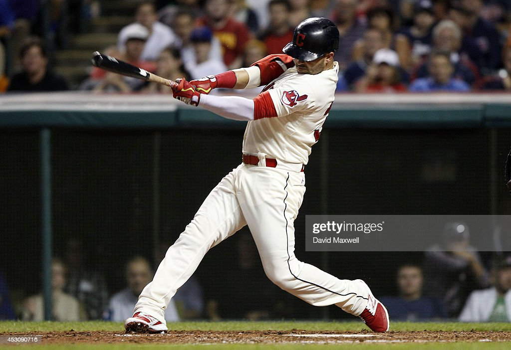 <a gi-track='captionPersonalityLinkClicked' href=/galleries/search?phrase=Nick+Swisher&family=editorial&specificpeople=206417 ng-click='$event.stopPropagation()'>Nick Swisher</a> #33 of the Cleveland Indians hits an RBI single to score Carlos Santana #41 (not pictured) against the Texas Rangers during the sixth inning of their game on August 2, 2014 at Progressive Field in Cleveland, Ohio.