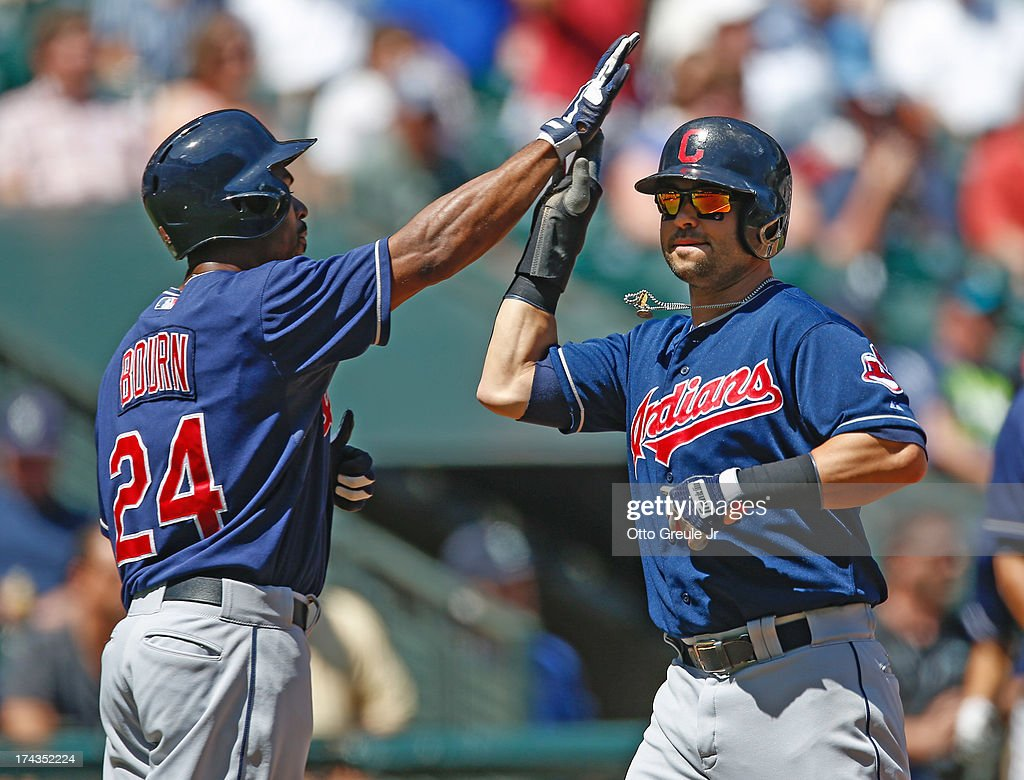 Nick Swisher #33 of the Cleveland Indians is congratulated by Michael Bourn #24 after both scored on a double by Asdrubal Cabrera against the Seattle Mariners in the first inning at Safeco Field on July 24, 2013 in Seattle, Washington.