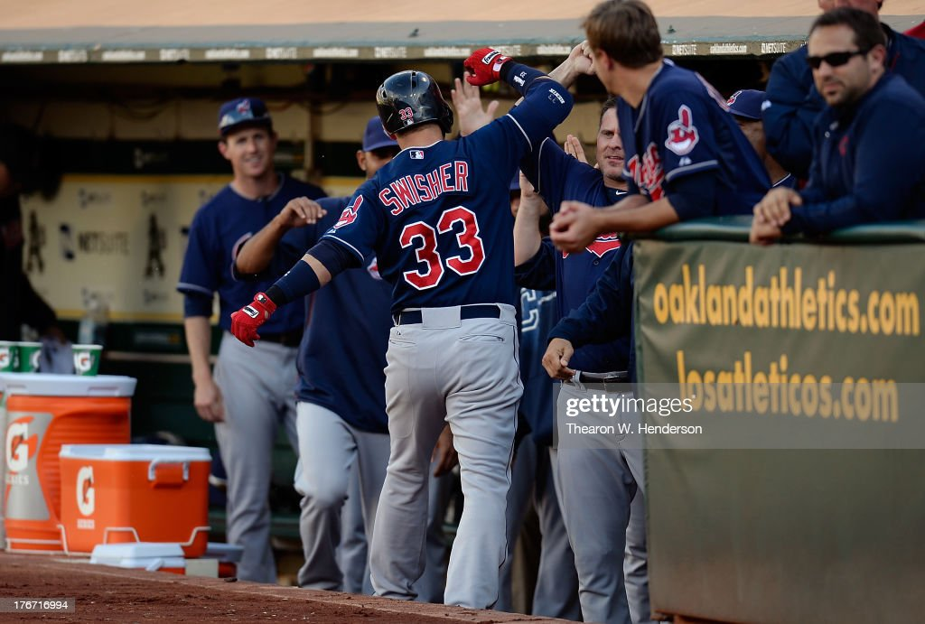 <a gi-track='captionPersonalityLinkClicked' href=/galleries/search?phrase=Nick+Swisher&family=editorial&specificpeople=206417 ng-click='$event.stopPropagation()'>Nick Swisher</a> #33 of the Cleveland Indians is congratulated by teammates after hitting a solo home run in the first inning against the Oakland Athletics at O.co Coliseum on August 17, 2013 in Oakland, California.
