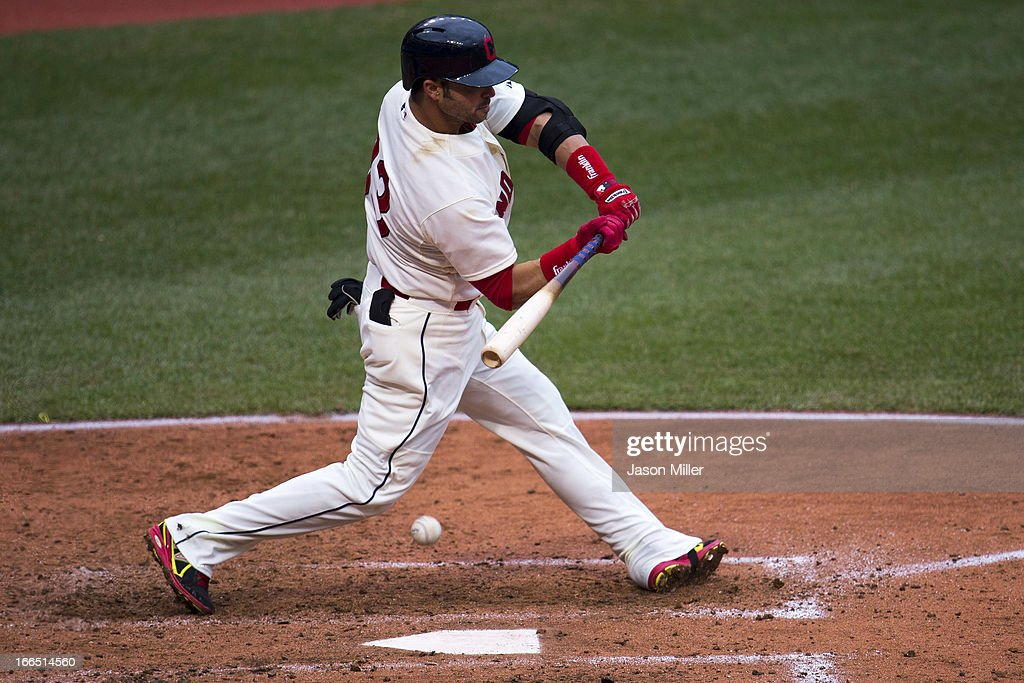 <a gi-track='captionPersonalityLinkClicked' href=/galleries/search?phrase=Nick+Swisher&family=editorial&specificpeople=206417 ng-click='$event.stopPropagation()'>Nick Swisher</a> #33 of the Cleveland Indians is hit by a pitch during the fifth inning against the Chicago White Sox at Progressive Field on April 13, 2013 in Cleveland, Ohio.