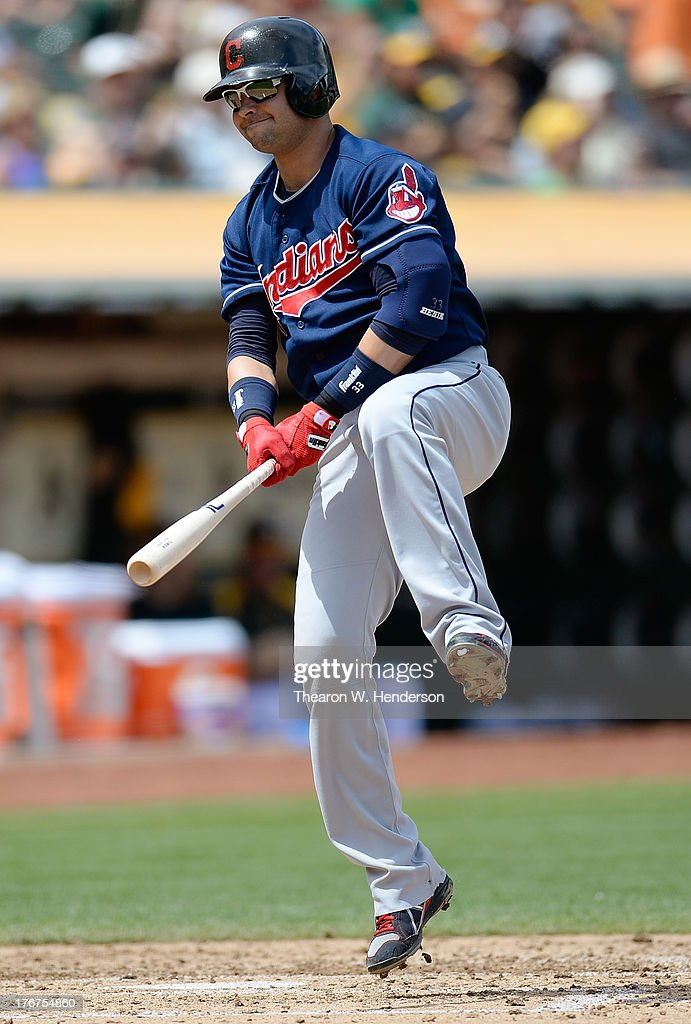 <a gi-track='captionPersonalityLinkClicked' href=/galleries/search?phrase=Nick+Swisher&family=editorial&specificpeople=206417 ng-click='$event.stopPropagation()'>Nick Swisher</a> #33 of the Cleveland Indians reacts to striking out in the third inning against the Oakland Athletics at O.co Coliseum on August 18, 2013 in Oakland, California.