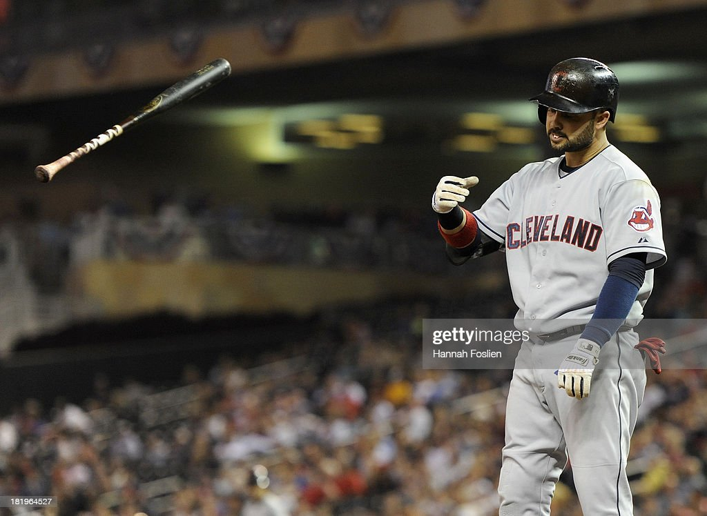 <a gi-track='captionPersonalityLinkClicked' href=/galleries/search?phrase=Nick+Swisher&family=editorial&specificpeople=206417 ng-click='$event.stopPropagation()'>Nick Swisher</a> #33 of the Cleveland Indians reacts to striking out with the bases loaded during the sixth inning of the game against the Minnesota Twins on September 26, 2013 at Target Field in Minneapolis, Minnesota.