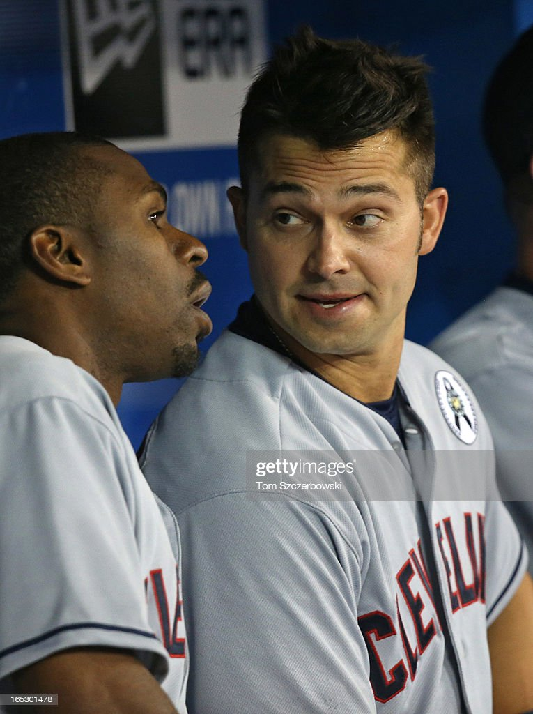 <a gi-track='captionPersonalityLinkClicked' href=/galleries/search?phrase=Nick+Swisher&family=editorial&specificpeople=206417 ng-click='$event.stopPropagation()'>Nick Swisher</a> #33 of the Cleveland Indians talks to <a gi-track='captionPersonalityLinkClicked' href=/galleries/search?phrase=Michael+Bourn&family=editorial&specificpeople=835742 ng-click='$event.stopPropagation()'>Michael Bourn</a> #24 in the dugout during MLB game action on Opening Day against the Toronto Blue Jays on April 2, 2013 at Rogers Centre in Toronto, Ontario, Canada.
