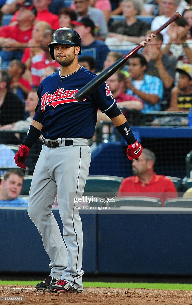 Nick Swisher #33 of the Cleveland Indians tosses his bat away after striking out against the Atlanta Braves at Turner Field on August 29, 2013 in Atlanta, Georgia.