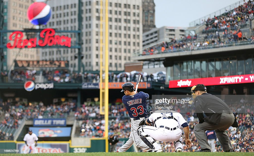 Nick Swisher #33 of the Cleveland Indians triples to right field in the fourth inning of the game against the Detroit Tigers at Comerica Park on May 10, 2013 in Detroit, Michigan. The Tigers defeated the Indians 10-4.