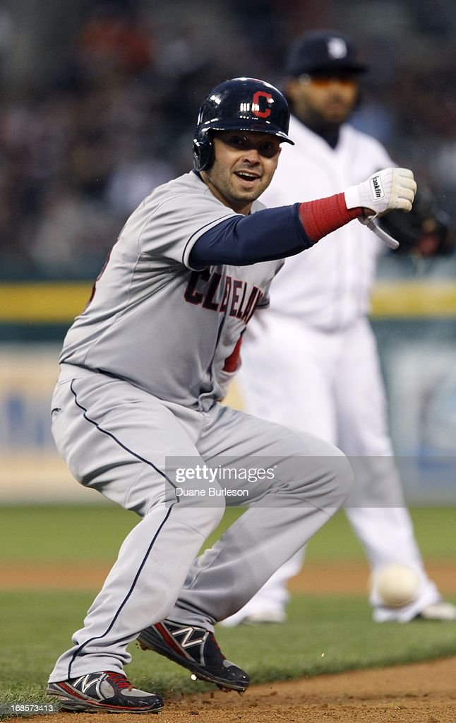 Nick Swisher #33 of the Cleveland Indians turns back towards second base after being caught in a rundown against the Detroit Tigers at Comerica Park on May 11, 2013 in Detroit, Michigan. Swisher made it safe to second base and scored later in the inning.