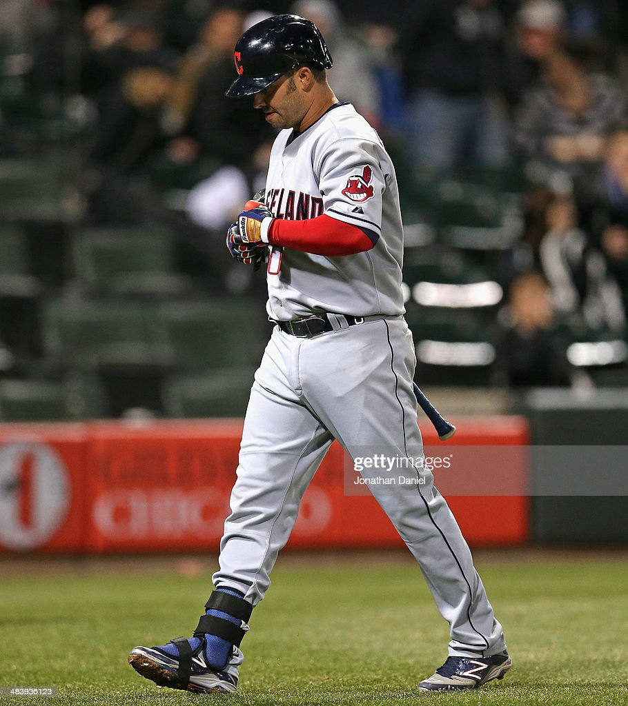 <a gi-track='captionPersonalityLinkClicked' href=/galleries/search?phrase=Nick+Swisher&family=editorial&specificpeople=206417 ng-click='$event.stopPropagation()'>Nick Swisher</a> #33 of the Cleveland Indians walks to the dugout after striking out in the 8th inning against the Chicago White Sox at U.S. Cellular Field on April 10, 2014 in Chicago, Illinois. The White Sox defeated the Indians 7-3.