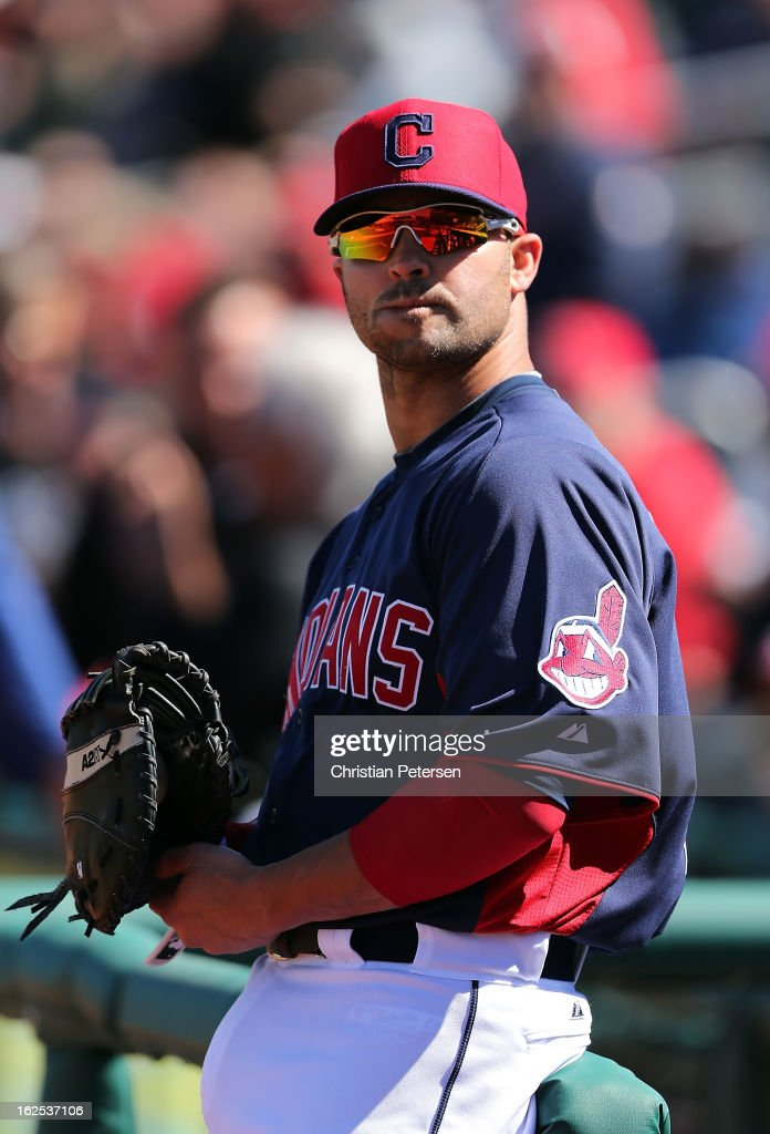 <a gi-track='captionPersonalityLinkClicked' href=/galleries/search?phrase=Nick+Swisher&family=editorial&specificpeople=206417 ng-click='$event.stopPropagation()'>Nick Swisher</a> #33 of the Cleveland Indians warms up before the spring training game against the Cincinnati Reds at Goodyear Ballpark on February 24, 2013 in Goodyear, Arizona