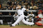Nick Swisher of the New York Yankees bats against the Philadelphia Phillies in Game Six of the 2009 MLB World Series at Yankee Stadium on November 4...