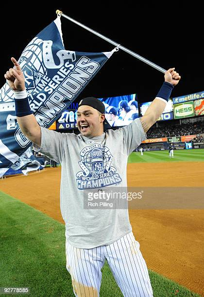 Nick Swisher of the New York Yankees celebrates after a 73 win against the Philadelphia Phillies in during Game Six of the 2009 MLB World Series at...