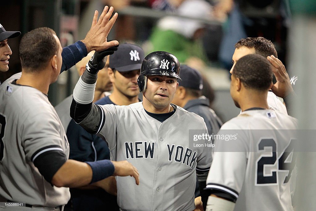 <a gi-track='captionPersonalityLinkClicked' href=/galleries/search?phrase=Nick+Swisher&family=editorial&specificpeople=206417 ng-click='$event.stopPropagation()'>Nick Swisher</a> #33 of the New York Yankees celebrates after scoring on the double from <a gi-track='captionPersonalityLinkClicked' href=/galleries/search?phrase=Andruw+Jones+-+Baseball+Player&family=editorial&specificpeople=203331 ng-click='$event.stopPropagation()'>Andruw Jones</a> #22 in the eighth inning during the game against the Detroit Tigers at Comerica Park on June 1, 2012 in Detroit, Michigan. The Yankees defeated the Tigers 9-4.