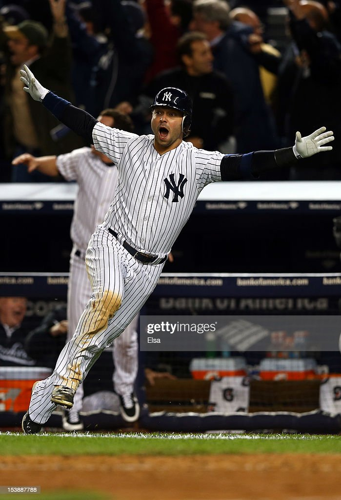 <a gi-track='captionPersonalityLinkClicked' href=/galleries/search?phrase=Nick+Swisher&family=editorial&specificpeople=206417 ng-click='$event.stopPropagation()'>Nick Swisher</a> #33 of the New York Yankees celebrates defeating the Baltimore Orioles in the bottom of the twelfth inning after a home run by Raul Ibanez #27 in Game Three of the American League Division Series at Yankee Stadium on October 10, 2012 in the Bronx borough of New York City.
