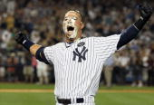 Nick Swisher of the New York Yankees celebrates his game winning RBI base hit in the ninth inning against the Tampa Bay Rays on July 16 2010 at...