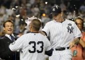 Nick Swisher of the New York Yankees celebrates his game winning RBI base hit in the ninth inning against the Tampa Bay Rays with a shaving cream pie...