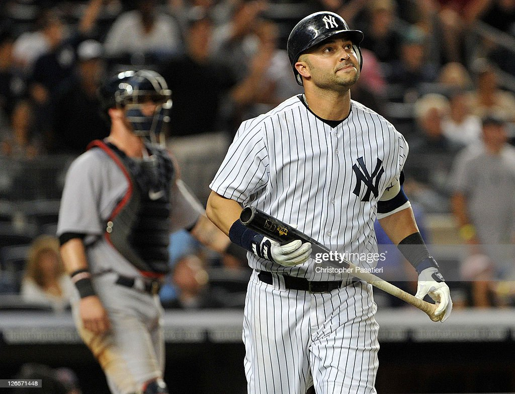 <a gi-track='captionPersonalityLinkClicked' href=/galleries/search?phrase=Nick+Swisher&family=editorial&specificpeople=206417 ng-click='$event.stopPropagation()'>Nick Swisher</a> #33 of the New York Yankees flies out to right in the bottom of the 13th inning against the Boston Red Sox on September 25, 2011 at Yankee Stadium in the Bronx borough of New York City.